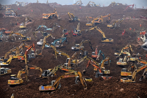 Excavators are seen during rescue operations at an industrial estate hit by a landslide in Shenzhen