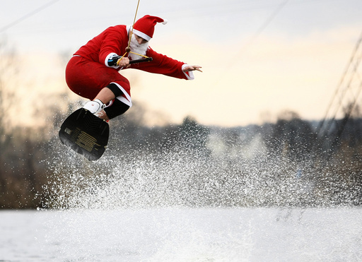 A man dressed as Santa Claus wakeboards in Hamburg