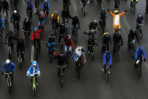 People take part in winter bicycle parade in Moscow
