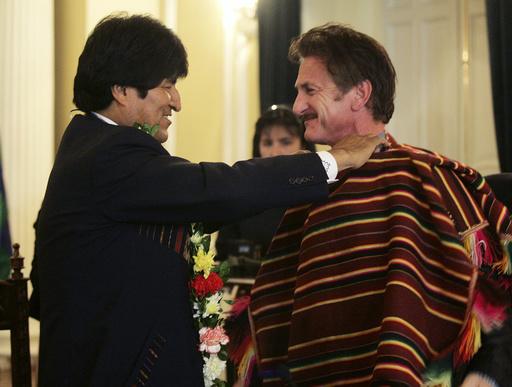 Actor Sean Penn receives a poncho from Bolivian President Evo Morales in La Paz