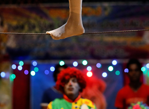 A member of Sakura circus team walks on a wire during the second day of a one week show in Padukka
