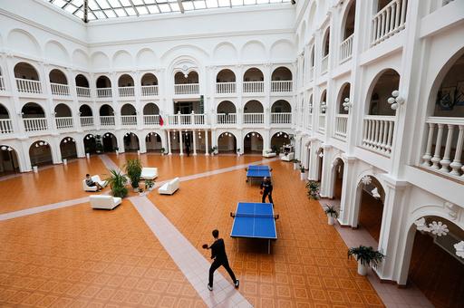 A boy plays table tennis with a teacher at the orphanage named after its founder Hazret Sovmen in central Krasnoyarsk
