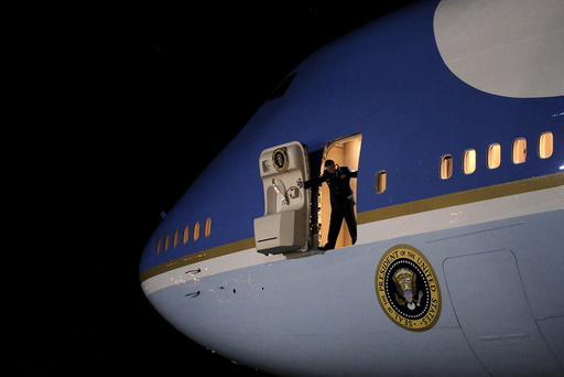 An Air Force personnel open the door of the the Air Force One as U.S. President Barack Obama arrive at Joint Base Andrews from New Jersey and New York, in Maryland