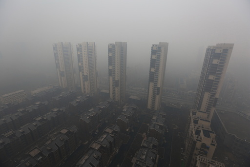 Residential buildings are seen shrouded in haze in Shenyang