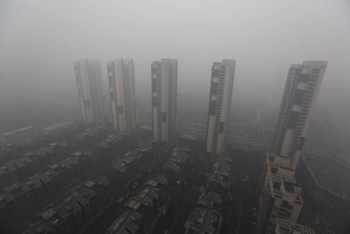 Residential buildings are seen shrouded in haze in Shenyang