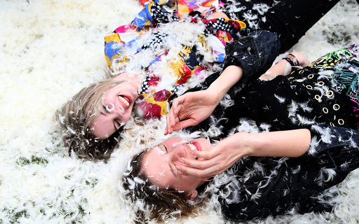 Participants take part in International Pillow Fight Day in Kennington Park in south London