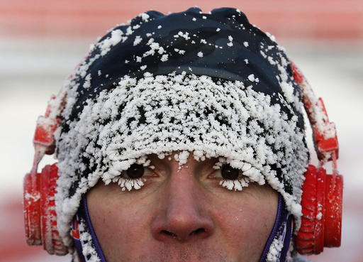 Runner with his face covered with hoarfrost competes during traditional half Marathon amateur competition marking Orthodox Christmas Day festivities in Krasnoyarsk