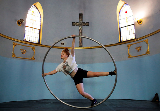 Aerial Emery trains on the cyr wheel at the Aloft Loft circus training and teaching school which was converted from a church in Chicago