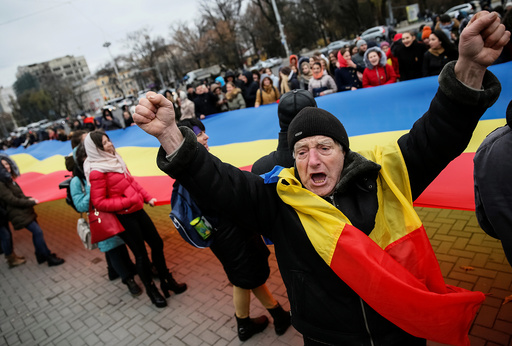 People take part in a rally against Moldova's President-elect Dodon representing the Socialist Party in Chisinau