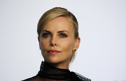 Cast member Charlize Theron attends a news conference for the film