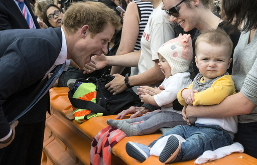 Britain's Prince Harry meets young members of the public during a walkabout tour of Christchurch's city mall in New Zealand