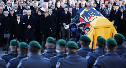 German army Bundeswehr soldiers carry the coffin holding the body of late former West German Chancellor Schmidt after the memorial service in St. Michael's Church in Hamburg