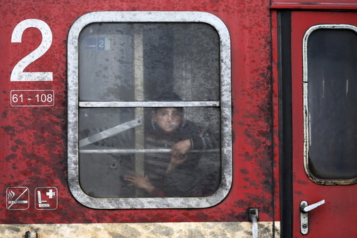 A migrant looks out of a train window near the Macedonian-Greek border in Gevgelija