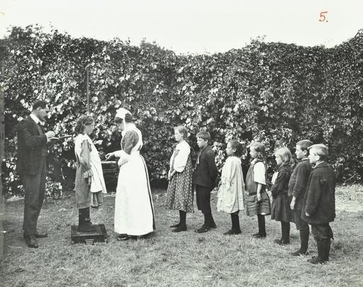 Children being weighed in the garden, Montpelier House Open Air School, London, 1908. Artist: Unknown.