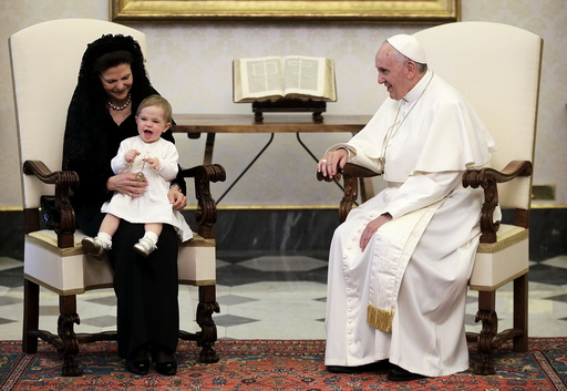 Pope Francis looks at a smiling Princess Leonore during a meeting with Sweden's Queen Silvia at the Vatican