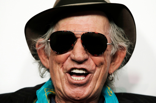 Keith Richards of The Rolling Stones poses for photographers as the band arrives for the opening of the new exhibit Exhibitionism: The Rolling Stonesin New York
