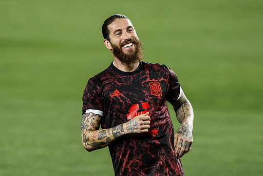 Spain's Sergio Ramos during the warm up prior of the World Cup 2022 group B qualifying soccer match between Spain and Greece at the Los Carmenes stadium in Granada, Spain, Thursday, March 25, 2021. (AP Photo/Fermin Rodriguez)