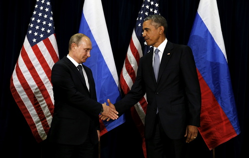 U.S. President Barack Obama shakes hands with Russian President Vladimir Putin during their meeting at the United Nations General Assembly in New York