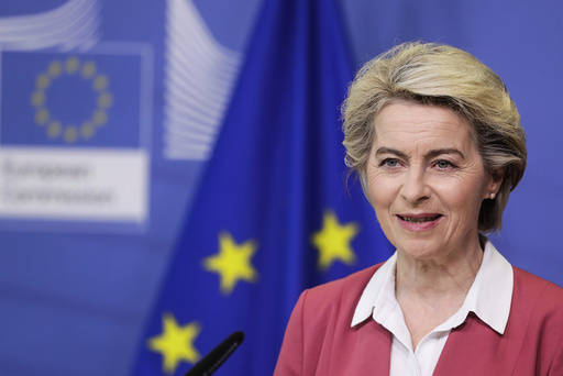 European Commission President Ursula von der Leyen delivers a statement at EU headquarters in Brussels, Tuesday, July 27, 2021. The European Union has achieved a major goal of providing at least one coronavirus shot to 70 percent of adults across the 27-nation bloc but member countries must step up their vaccination rates to combat fast-spreading variants of the disease, the EU's chief executive warned Tuesday. (Stephanie Lecocq, Pool Photo via AP)