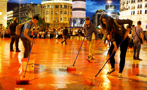 Protesters disperse color paint during a protest against the government, at central square in Skopje