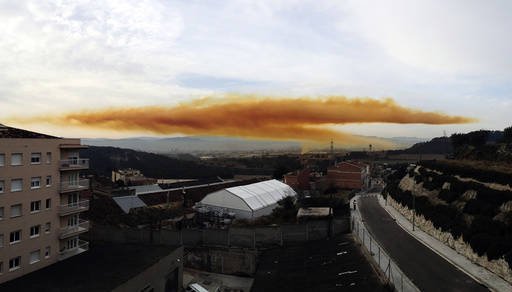 Orange toxic cloud is seen over the town of Igualada, near Barcelona, following an explosion in a chemical plant