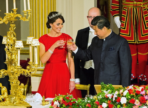 Chinese President Xi Jinping with the Duchess of Cambridge at a state banquet at Buckingham Palace, London, during the first day of his state visit to Britain