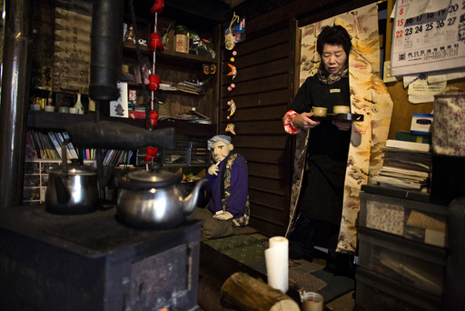 Tsukimi Ayano serves tea in her house in the village of Nagoro