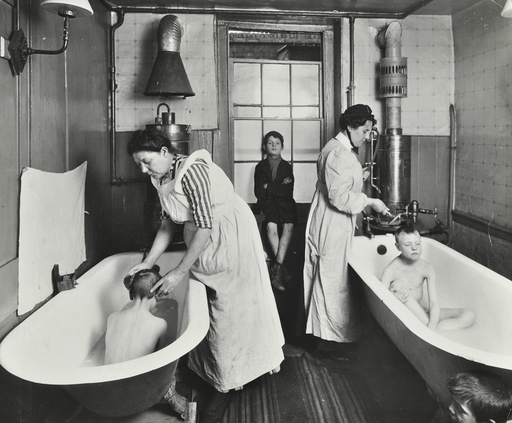 Attendants bathing boys at the Central Street Cleansing Station, London, 1914. Artist: Unknown.