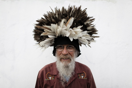Moreno poses for a photograph with a wig made with pigeon feathers in downtown Monterrey