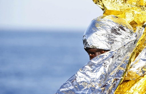 A migrant waits to disembark from the rescue vessel Responder in the Italian harbour of Vibo Marina, Italy