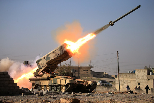 Iraqi army launch a rocket towards Islamic State militants during a battle with Islamic State militants near Ghozlani military complex, south of Mosul