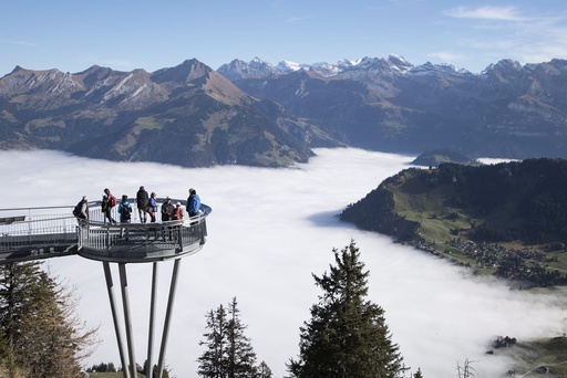 Day-trippers enjoy the sunny weather on the Stanserhorn