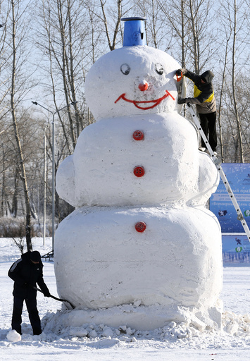 Men work on a 5 meters high snowman at a park in a Siberian city of Krasnoyarsk