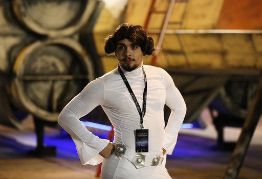 Star Wars fan Josh Lynch, dressed as Princess Leia poses for a photograph in front of an X-wing fighter at the 'For The Love of The Force' fan convention in Manchester , northern England