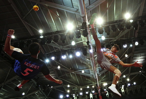 Thailand's Pornchai Kaokaew blocks a shot by Singapore's Muhammad A'Fif Safiee during their men's team sepak takraw preliminary round match at SEA Games in Singapore
