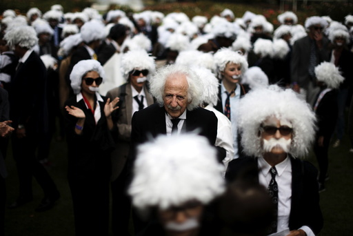 Benny Wasserman, stands with others dressed as Albert Einstein as they gather to establish Guinness world record for largest Einstein gathering, to raise money for School on Wheels and homeless children's education, in Los Angeles
