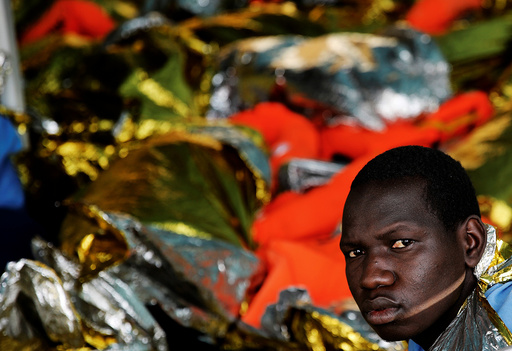 A migrant looks on onboard the former fishing trawler Golfo Azzurro after he was rescued along with other migrants by the Spanish NGO Proactiva Open Arms as the raft he was on drifted out of contol in the central Mediterranean Sea