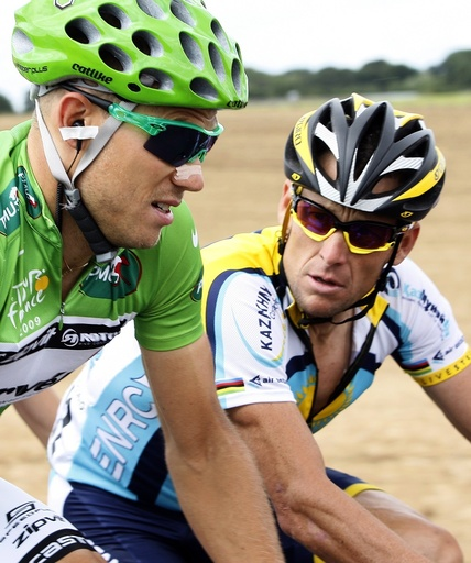 Astana rider Armstrong cycles with Cervelo Test Team rider Hushovd during eleventh stage of 96th Tour de France cycling race