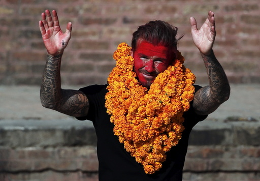 David Beckham waves toward his fans while on his way back after playing a charity match to collect funds for UNICEF at the ancient city of Bhaktapur