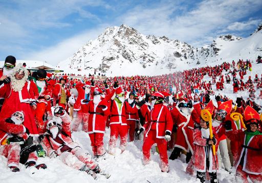 People dressed as Santa Claus enjoy the snow during the Saint Nicholas Day at the Alpine ski resort of Verbier