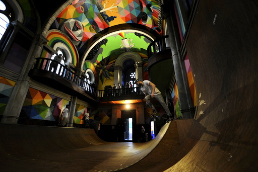 A man practises skateboarding inside the desconsecrated Santa Barbara church in Llanera, northern Spain