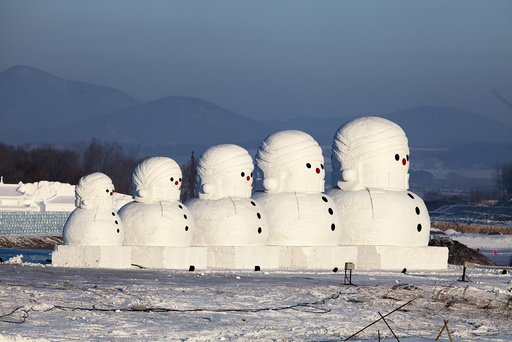 Giant snow sculptures in the shape of Russian traditional Matryoshka dolls are displayed at a tourist resort in Jilin