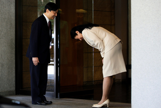 Japan's Crown Princess Masako bows to her husband Crown Prince Naruhito before he leaves for Malaysia at Togu Palace in Tokyo