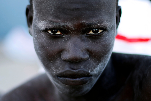 A migrant arrives at a naval base after he was rescued by Libyan coastal guards in Tripoli