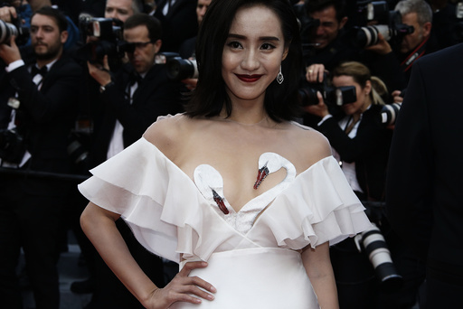 A guest poses on the red carpet as she arrives for the opening ceremony and the screening of the film Cafe Society out of competition during the 69th Cannes Film Festival in Cannes