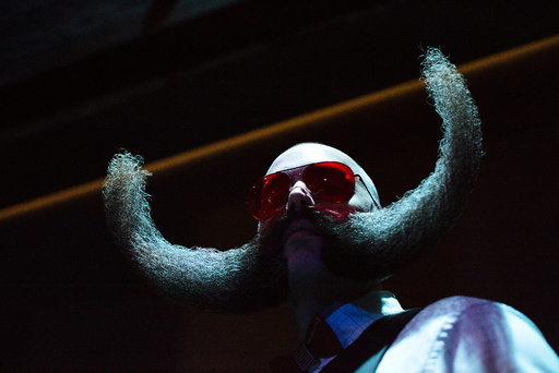 M.J. Johnson from Minneapolis, Minnesota, poses for a photograph at the 2015 Just For Men National Beard & Moustache Championships at the Kings Theater in the Brooklyn borough of New York