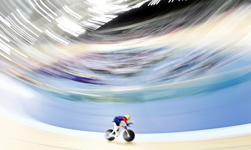 Bradley Wiggins pedals during his attempt to break cycling's hour record at the Olympic velodrome in East London, Britain