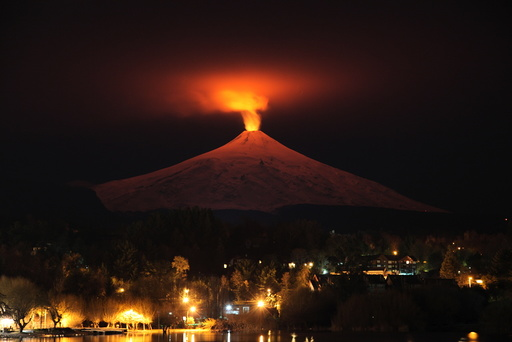The Villarrica Volcano is seen at night from Pucon town07