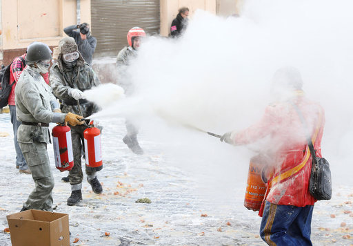 Revellers battle with flour and eggs during the traditional Els Enfarinats (The Floured) festival in Ibi