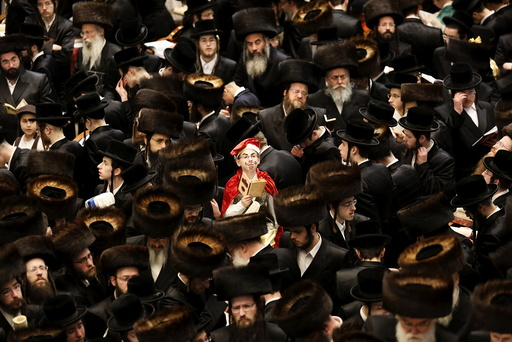 An Ultra-Orthodox Jewish boy from the Belz Hasidic dynasty dressed in a Purim costume takes part in the reading from the Book of Esther ceremony performed on the Jewish holiday of Purim, in Jerusalem